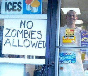 No zombies allowed sign on a liquor store door.